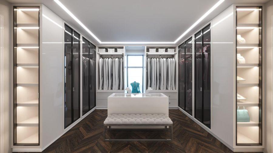 5bb4bd6d71b99 Белый гардероб с тонированными стеклянными дверями. Встроенная подсветка в  интерьере гардеробной комнаты