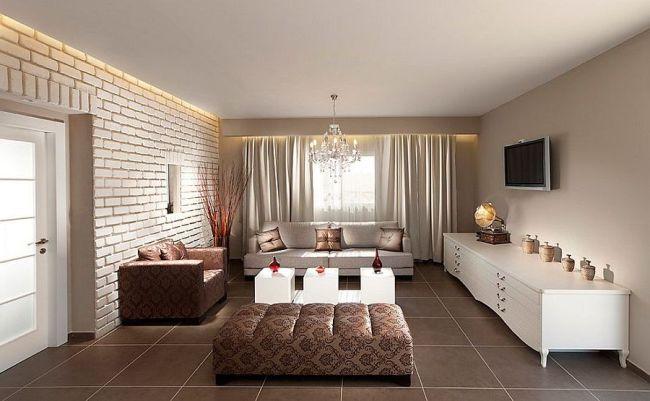 Современная гостиная в светлых тонах и крупной кирпичной кладкой